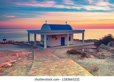 Cyprus, Mediterranean Sea coast. Agioi Anargyroi church at Cape Greco at sunrise