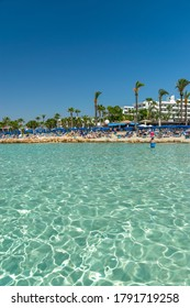 CYPRUS, NISSI BEACH - MAY 12/2018: Tourists relax and swim on one of the most popular beaches on the island.