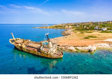 Cyprus. Pathos. White stone. Shipwreck. The ship ran aground top view. The ship crashed on the coastal rocks. Rusty ship at the shore of the Mediterranean sea. Tourist attractions of Cyprus.