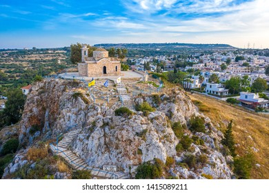 Cyprus. Protaras. Church of the holy prophet Elijah bird's-eye view. Greek orthodox church on the rocks rises above the village. Cyprus church in the Byzantine style. Tourist landmarks of Protaras.