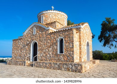 Cyprus. Protaras. Church of the holy prophet Elijah. Greek orthodox church on the rocks rises above the village. Cyprus church in the Byzantine style. Tourist landmarks of Protaras.