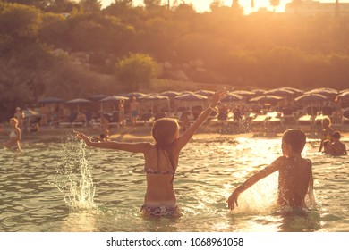 Cyprus summer, children enjoy and playing in the water on the Cyprus beach.