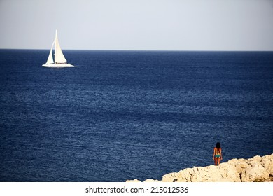 CYPRUS,AYIA NAPA-SEPTEMBER 3: A woman watches a ship sails in Ayia Napa on September 03,2014