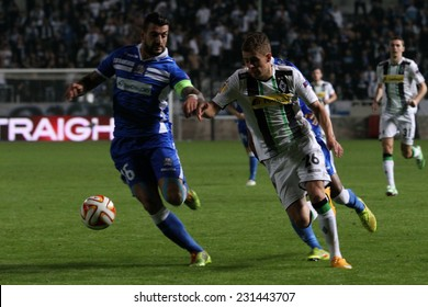 CYPRUS,NICOSIA- NOV 6:Apollon Limassol FC player Georgios Merkis fight for the ball with Borussia Monchengladbach's Thorgan Hazard  during the Uefa Europa League game   in Gsp Stadium on November 6,