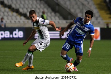 CYPRUS,NICOSIA- NOV 6:Apollon Limassol FC player Farley fight for the ball with Borussia Monchengladbach's Thorgan Hazard  during the Uefa Europa League game   in Gsp Stadium on November 6,2014