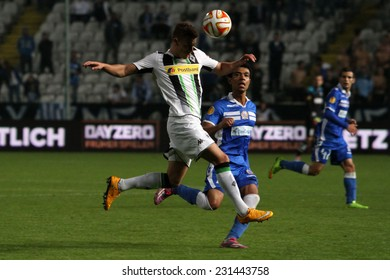 CYPRUS,NICOSIA- NOV 6:Apollon Limassol FC player Farley fight for the ball with Borussia Monchengladbach's Christoph Kramer  during the Uefa Europa League game   in Gsp Stadium on November 6,2014