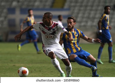 CYPRUS,NICOSIA - NOV 7:Apoel FC player Nectarios Alexandrou and Bordeaux  playerJussie  fight for the ball during their Europa League  soccer match at GSP stadium in Nicosia, Cyprus Nov. 07, 2013