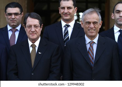 CYPRUS,NICOSIA-MARCH 01,2013:The new president of Cyprus Nicos Anastasiadis (L)and the new minister of Finance Michalis Sarris(R) during a family photo of the new government of Cyprus on March 1,2013