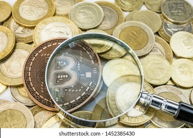 cyripto money mining. close up physical bitcoin coin with magnifying glass and turkish metal coins.