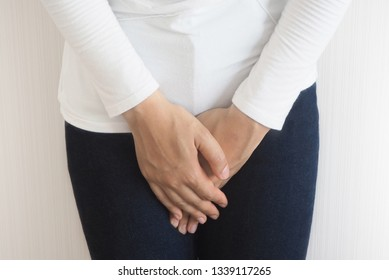 Cystitis in asian woman and hand holding pressing her crotch lower abdomen case of abdominal pain with isolated on white background using for health care concept.