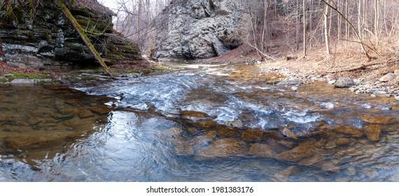 The Czarny Potok stream flowing next to the cave in Rosolina, Polana, Bieszczady mountains  - Shutterstock ID 1981383176