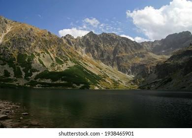 Czarny Staw Gasienicowy - Black Lake, mountain glacial lake in Tatra Mountains, Poland - Shutterstock ID 1938465901