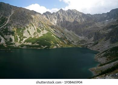 Czarny Staw Gasienicowy - Black Lake, mountain glacial lake in Tatra Mountains, Poland - Shutterstock ID 1938465904