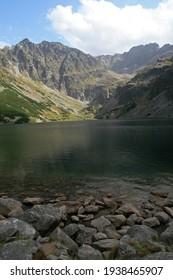 Czarny Staw Gasienicowy - Black Lake, mountain glacial lake in Tatra Mountains, Poland - Shutterstock ID 1938465907