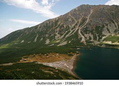 Czarny Staw Gasienicowy - Black Lake, mountain glacial lake in Tatra Mountains, Poland - Shutterstock ID 1938465910
