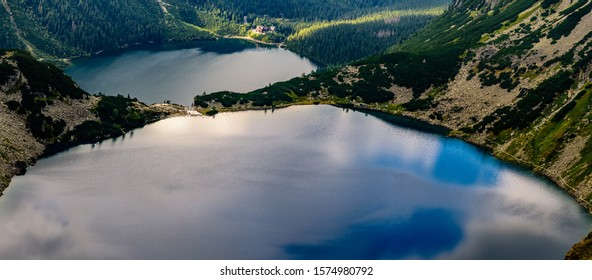 Czarny Staw pod Rysami (Black Lake below Mount Rysy) is a mountain lake on the Polish side of Mount Rysy in the Tatra mountains. At 1,583 m above sea level, it overlooks the nearby lake of Morskie Oko - Shutterstock ID 1574980792