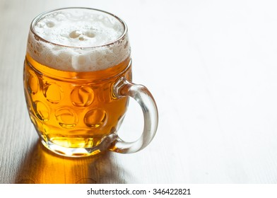 czech beer in the glass on vintage background
