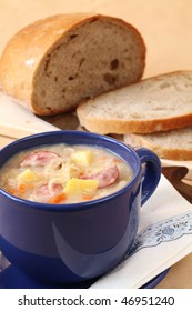 Czech cabbage soup made from sauerkraut with potato, carrot and meat sausage