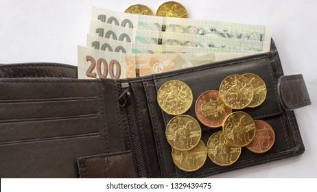 Czech coin on the various Czech banknotes money with leather wallet. Hundred crowns, two hundred crowns, twenty crowns coins, ten
