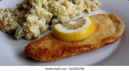 czech dish chicken cut and potato salad