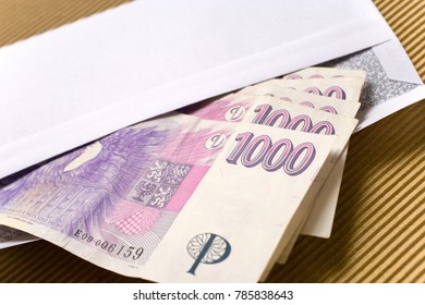 czech economy and finance - czech crown banknotes in a envelope - bribe and corruption concept