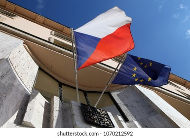 Czech and Europe Union flags on the building with the emblem of the Czech Republic.
