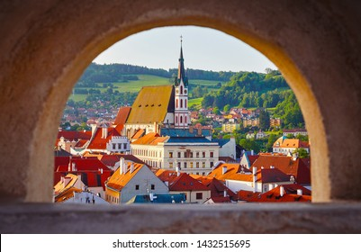 Czech Krumlov Czech Republic view at old town through window with arch. Landmark and traveling.