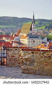 Czech Krumlov Czech Republic. View at old church with stone terrace. Landmark and travel. Evening landscape.