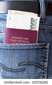Czech passport with money in the back pocket of woman's jeans..
