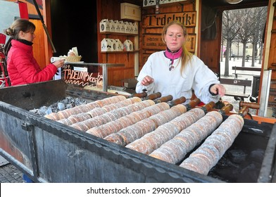 CZECH ,PRAGUE â??MARCH 7: Unidentified female sales trdelnik (Trdlo)  (Czech traditional sweet pastries) on March 7 2015 in Prague,Czech Republic.