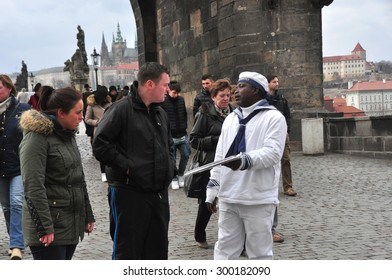 CZECH PRAGUE MARCH 7: Unidentified male suggesting boat city walk on old town square on March 7 2015 in Prague,Czech Republic.