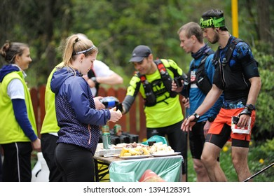 Czech Republic, Beskydy: May 2019. Perun Sky Marathon. Runners at a refreshment station.