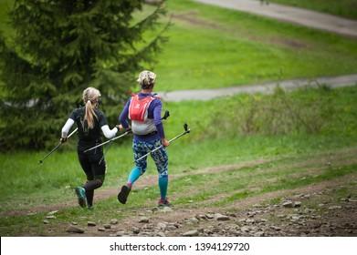 Czech Republic, Beskydy: May 2019.  Perun Sky Marathon. Women running downhill from Javorovy Hill.