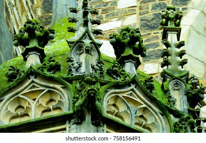 Czech republic, Brno city, gothic mossy stonework decor on the cathedral facade. Old medieval church exterior.