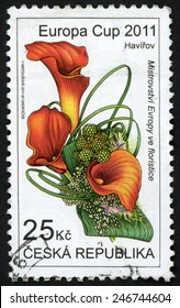 CZECH REPUBLIC - CIRCA 2011: stamp printed in Ceska (Czechoslovakia) shows arrangement with Zantedeschia flowers (lily); Europa cup florist championship Havirov; Scott 3506 25k red green, circa 2011