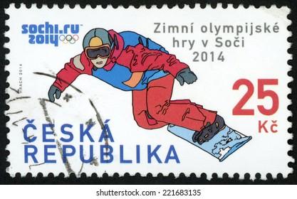 CZECH REPUBLIC - CIRCA 2014: post stamp printed in Czechoslovakia (Ceska) shows snowboarder; XXII. winter Olympic games in Sochi, Russia; 25k red blue, circa 2014