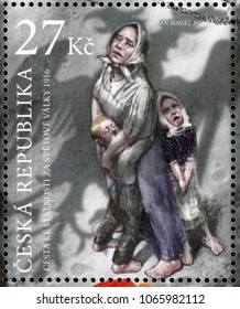 CZECH REPUBLIC - CIRCA 2016: post stamp printed in Ceska republika shows single mother or widow with two crying kids and shadow of Austrian imperial eagle; 1916 fight for Czech Statehood; circa 2016