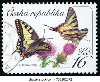 CZECH REPUBLIC - CIRCA 2016: stamp printed in Ceska (Czechoslovakia) shows scarce (Iphiclides podalirius) and common yellow swallowtail (Papilio machaon) batterflies on purple flowers; 16k; circa 2016