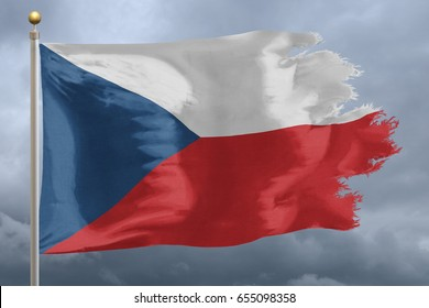 Czech Republic flag with torn edges in front of a stormy sky