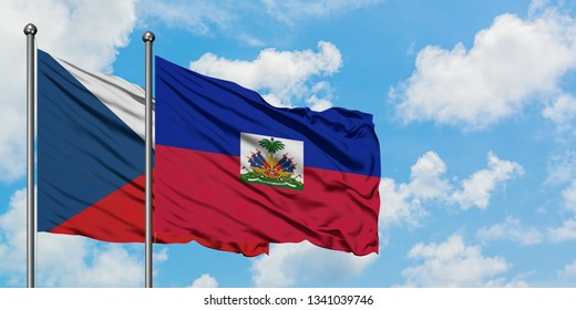 Czech Republic and Haiti flag waving in the wind against white cloudy blue sky together. Diplomacy concept, international relations.