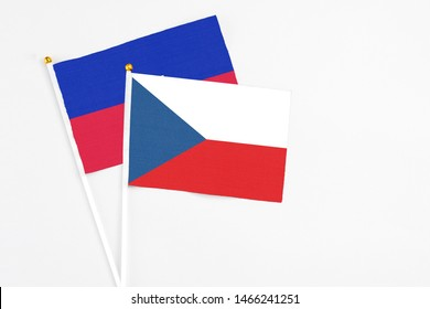 Czech Republic and Haiti stick flags on white background. High quality fabric, miniature national flag. Peaceful global concept.White floor for copy space.