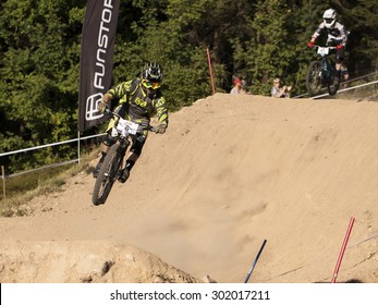 CZECH REPUBLIC, JABLONEC NAD NISOU - JULY 25, 2015 - JBC 4X Revelations: Fourcross bikes race. Detail of biker on the jump.