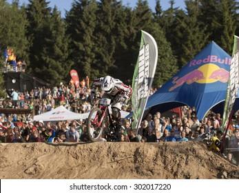 CZECH REPUBLIC, JABLONEC NAD NISOU - JULY 25, 2015 - JBC 4X Revelations: Fourcross bikes race. Detail of biker with people on background.