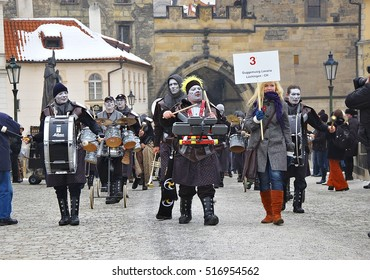 CZECH REPUBLIC - JANUARY 22, 2010: Euro Carnevale Prague 2010 starts at the Charles Bridge.  Ensembles of drummers and brass bands in the carnival procession through the streets.  Editorial Use Only