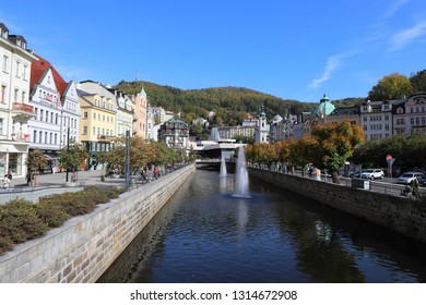 CZECH REPUBLIC, KARLOVY VARY, DIVADELNI NAM. - STARA LOUKA - OCTOBER 04, 2018: View on River Tepla, Hot Spring Colonnade and Church of Saint Mary Magdalene.