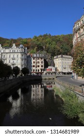 CZECH REPUBLIC, KARLOVY VARY, MIROVE NAM. - MARIANSKOLAZENSKA, OCTOBER 04, 2018: Buildings are mirroring in the river Tepla.