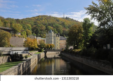 CZECH REPUBLIC, KARLOVY VARY, NABR. J. PALACHA, OCTOBER 04, 2018: Buildings at the Tepla river beside the city park Dvorakovy Sady