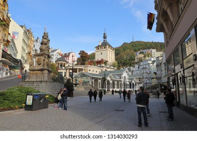 CZECH REPUBLIC, KARLOVY VARY, TRZISTE - OCTOBER 04, 2018: Market  Colonnade, Castle Tower and Holy Trinity Column in Carlsbad.