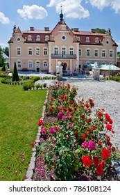 CZECH REPUBLIC, KUNICE - JUN 15, 2015: castle Berchtold from 1877 and park with model miniatures of czech landmarks, Benice, Vidovice village, Czech republic.