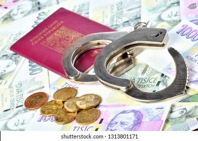 Czech republic passport, coins and police handcuffs on banknotes - international arrest warrant concept